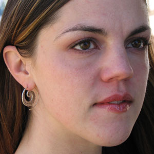 Sarah wearing Karen Tribe Silver Flat Spiral Earrings with Leaf Design