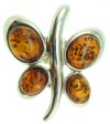 Butterfly finger ring hand crafted from sterling silver and real Baltic amber.