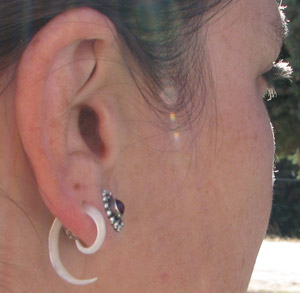"Dawna wearing 10 gauge Compact Mother Of Pearl Spirals with 7/16"" silver plugs"
